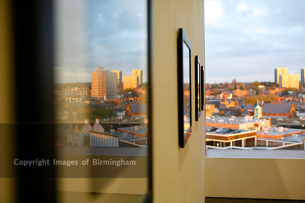 The New Art Gallery Walsall.  Walsall is reflected in the framed artwork on display.