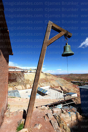 Bell used to summon workers in historic mining town of Pulacayo, Potosi Department, Bolivia