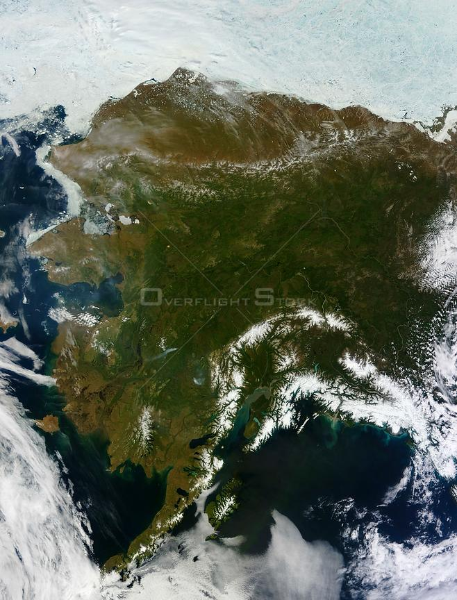 EARTH USA Alaska -- Alaska, obscuring most of the state's 6,640 miles (10,690 kilometers) of coastline and 586,000 square miles (1,518,000 square kilometers) of land.