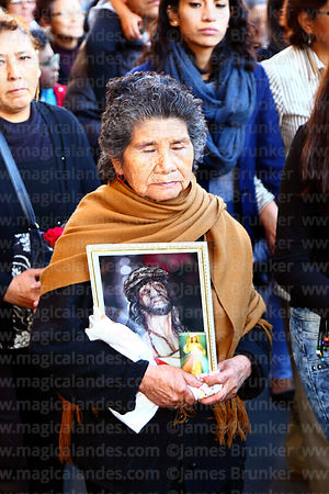 Devotee carrying a picture of Jesus wearing the crown of thorns during Good Friday procession, La Paz, Bolivia