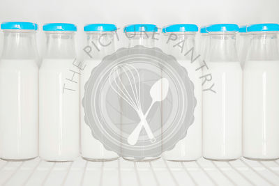Glass bottles of organic milk.
