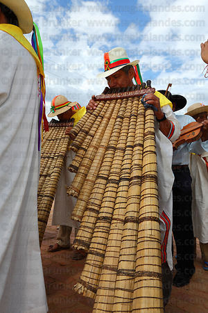 Musician playing Bajon Grande during main procession, San Ignacio de Moxos, Bolivia