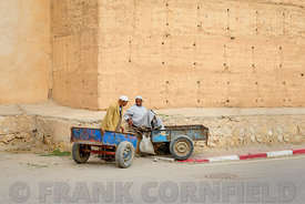 TAROUDANT, MOROCCO – NOVEMBER 02, 2015: Two porters waiting for work outside the city walls in Taroudant, Morocco.