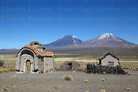 Ruined Rosario chapel at Estancia Huincurata and Payachatas volcanos, Sajama National Park, Bolivia