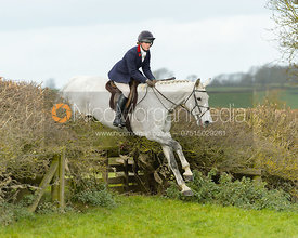 Grace Perry jumping a fence near Gartree Covert