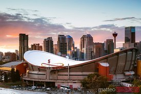 Saddledome stadium and skyline at sunset, Calgary, Canada