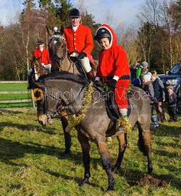 Richard Hunnisett MFH and his daughter Olivia get into the festive spirit - Belton 24/12