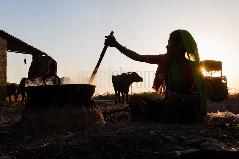 Woman Preparing Buffalo Milk for Sweet Manufacture