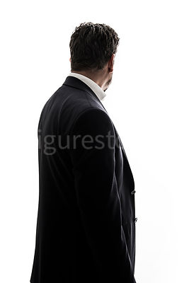 A mystery man in a suit, looking away – shot from eye level.