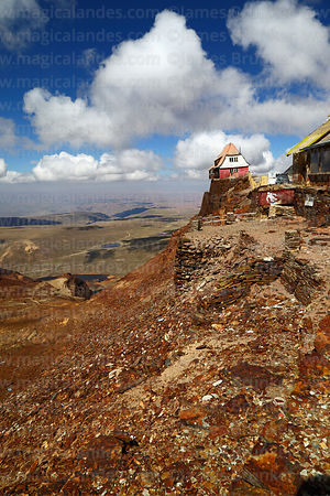 View looking down what was once the glacier, old ski hut in background, Mt Chacaltaya, Bolivia