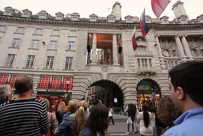 Crowds Watch as Hand Balancing Acrobats Perform in Regent Street