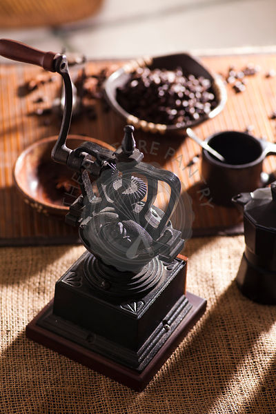 Coffee mill with roasted coffee beans