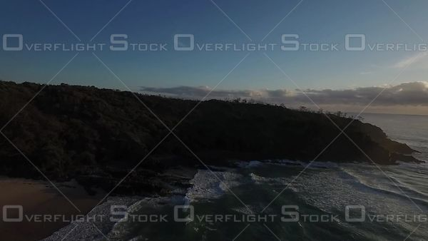 Slow sunrise flight over headland Australia