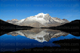 Mt Huayna Potosí  reflected in small lake soon after sunrise, Cordillera Real, Bolivia