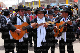 Musicians playing acoustic guitars and charango, Virgen de la Candelaria festival, Puno, Peru