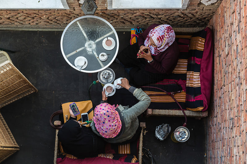 Arab Women Drinking Tea and Smoking a Hookah
