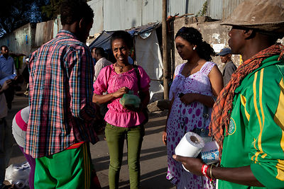 Ethiopia - Addis Ababa - Women bargain for an item on the street