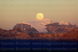 Full moon rising directly behind Mt Mururata (3 of a series of 4 images), Cordillera Real, Bolivia
