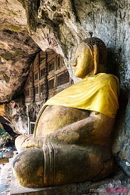 Laos, Luang Prabang. Buddha statue at the entrance of Pak Ou Caves