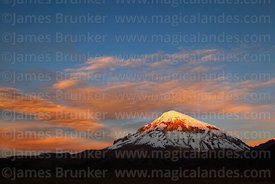 Last light on peak of Sajama volcano at sunset, Sajama National Park, Bolivia