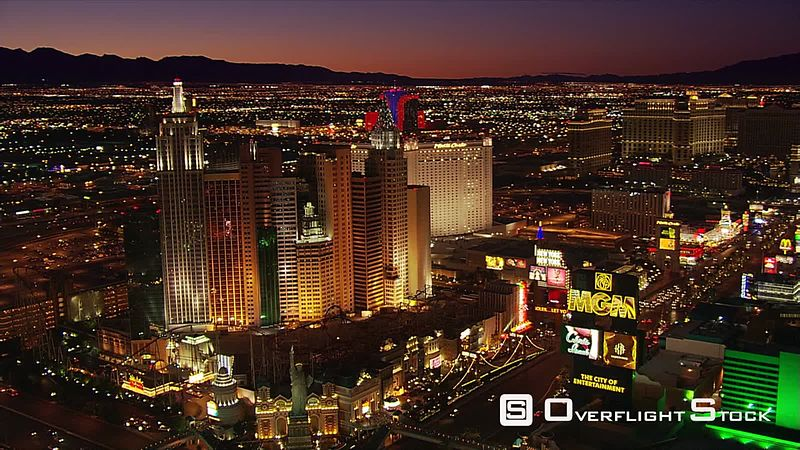 Wide aerial view of Las Vegas casinos at night.