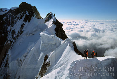 Climbers on a knife-edged ridge