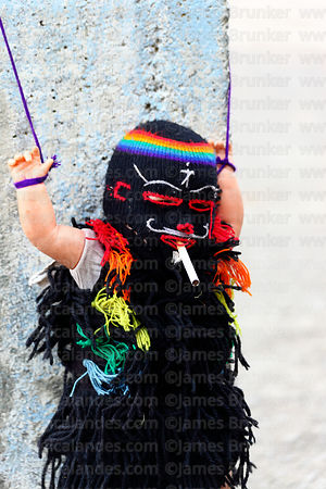 Doll in form of masked Ukuku / Pablito / Pablucha dancer with a cigarette, Qoyllur Riti festival, Peru