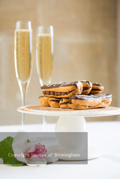 Chocolate eclairs and champagne