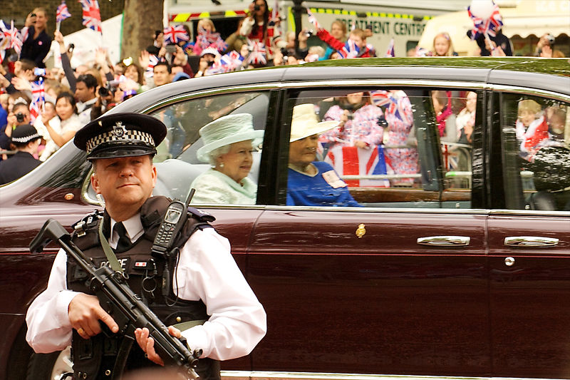 Armed Policeman as The Queen Passes by in her Car