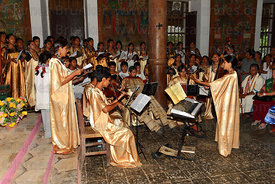 Local choir and orchestra with bajon playing in Jesuit Mission church during mass, San Ignacio de Moxos, Bolivia