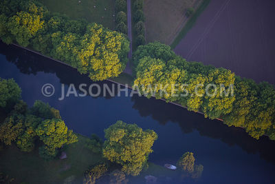 Aerial view of River Thames with trees and countryside.