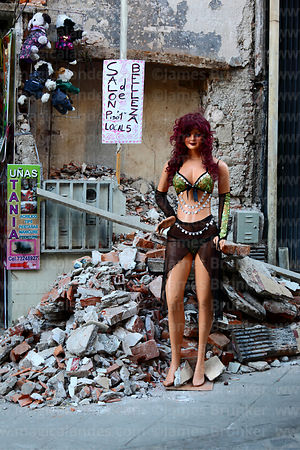 Beauty salon mannequin outside building that is being demolished, La Paz, Bolivia