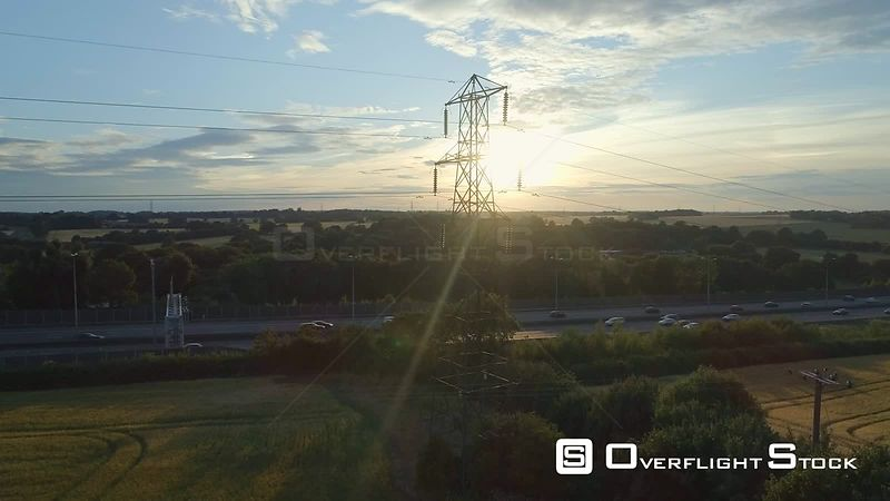 High Voltage Transmission Tower and Power Lines and Highway Countryside UK Drone Video