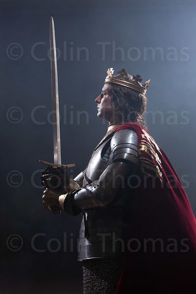King in armour with cloak photos