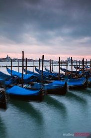Gondolas at sunset, St. Mark's square, Venice, Italy