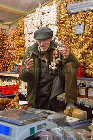 Onion and Garlic producer selling his wares  at the Ghent Christmas Market