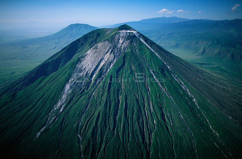 Aerial view of Ol Doinyo Lengai  (The Mountain of God) Volcano, Rift Valley, Tanzania. Note- light gray flows known as 'squeeze-ups' from the highly fluid lava, still active.