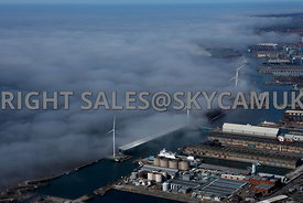 Liverpool aerial photograph of Low lying cloud and fog over the River Mersey and Liverpool Docks with the wind turbines rising above the fog
