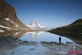 Hiker looking at Matterhorn, Riffelsee, Switzerland