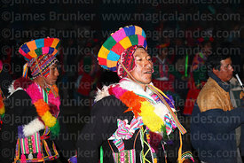 Male dancers performing in front of Sanctuary at night, Qoyllur Riti festival, Peru