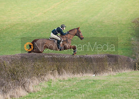 Annabel Bealby jumps a big hedge early on the course
