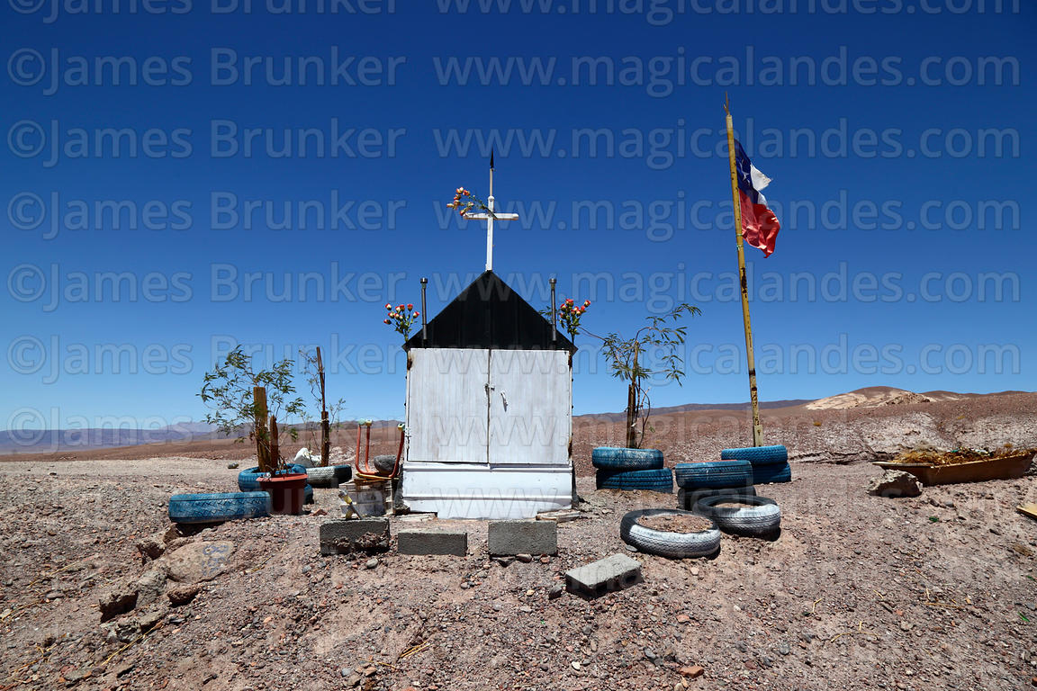 Roadside shrine (called animita de carretera in Chile) to traffic accident victim next to road between San Pedro de Atacama and Calama, Region II, Chile