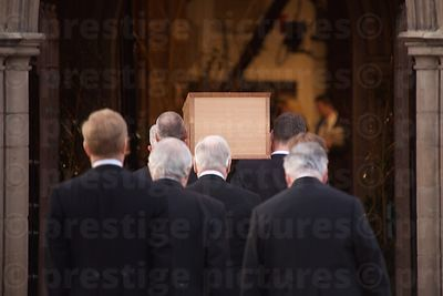 Richard III's Coffin is Carried Through the Entrance to  Leicester Cathedral