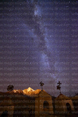 Milky Way and shooting star over Mt Huayna Potosí and Milluni cemetery, Cordillera Real, Bolivia