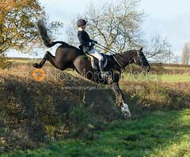 Katie Barber jumping a hedge at Barrowcliffe Farm 18/11