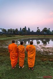 Three monk at Angkor Wat temples, at dawn, Cambodia