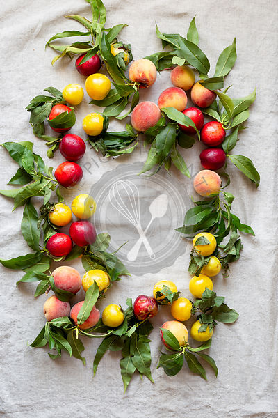 Fresh farm peaches laid our on a linen cloth