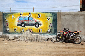 Motorbike and mural on wall of Avaroa Carwash, Uyuni, Bolivia