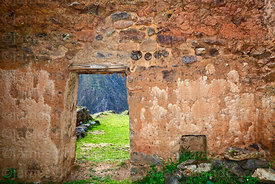 Trapezoid doorway with wooden lintel in wall of  building in Inca site of Pumamarca, Patacancha Valley, Cusco Region, Peru