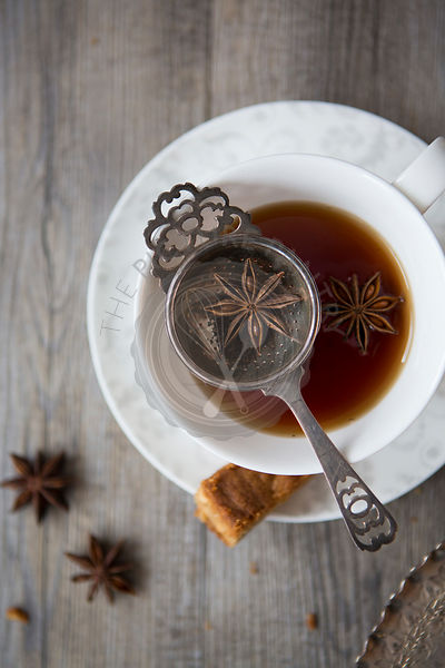 Tea with Tea Strainer in a Cup & Saucer